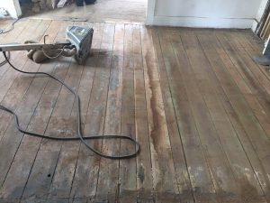 Original floors being refinished in the Zionsville Victorian.